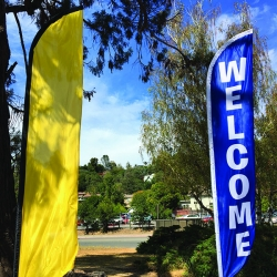 Yellow feather flag and welcome feather flag